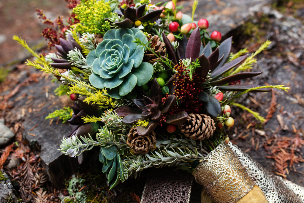 Fall succulent bouquet with berries and pine cones