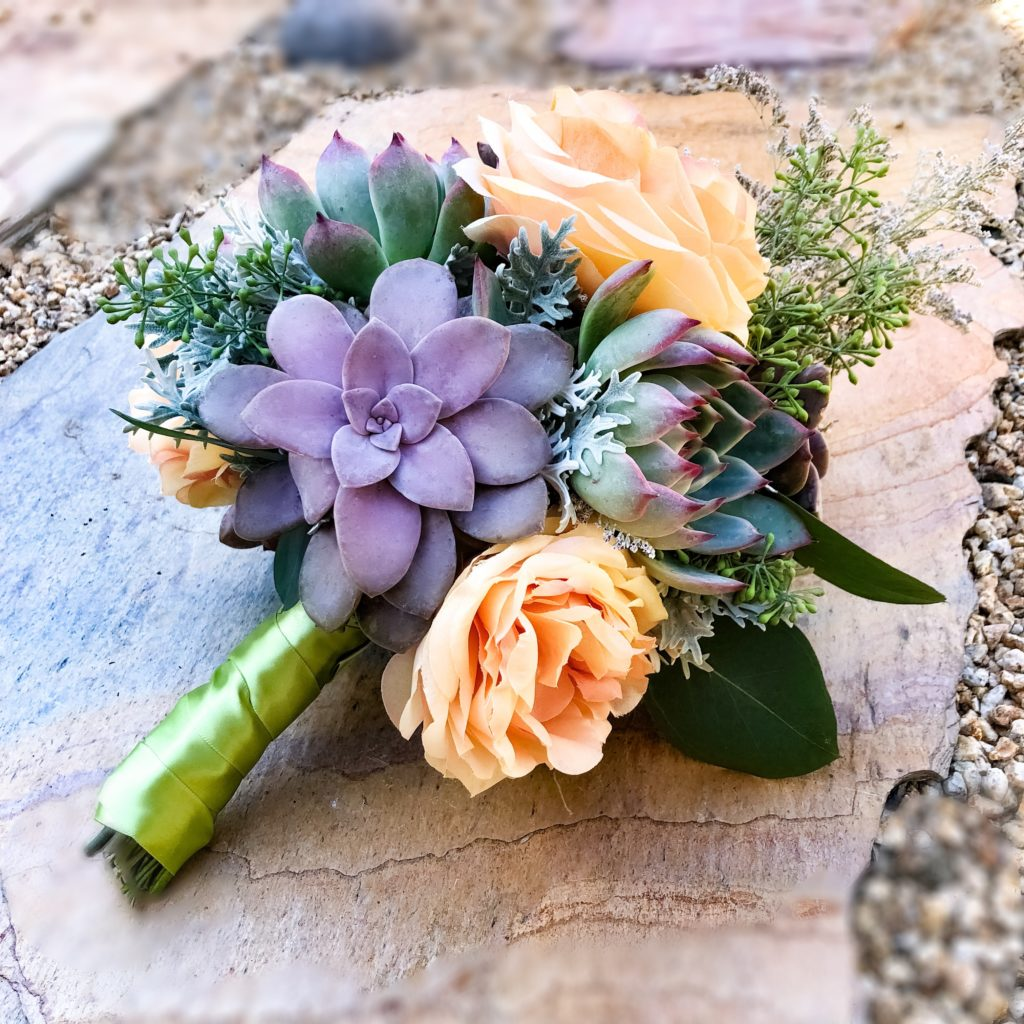 peach roses and purple succulent bouquet