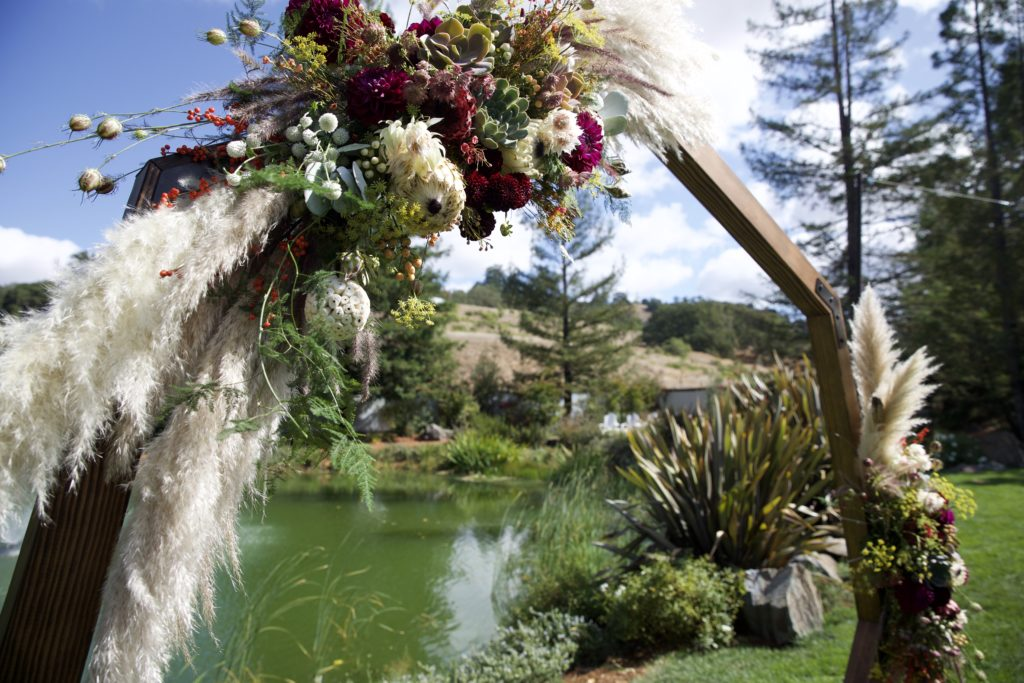 boho wedding hexagon arch with pampas grass and succulents