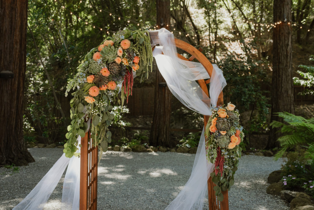 succulent and floral-adorned arch whimsical and romantic redwood wedding at Deer Park Villa in Fairfax, CA