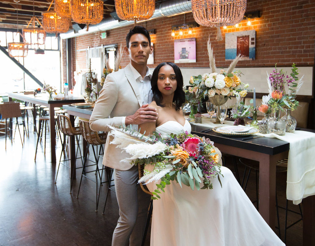 bride and groom at Oeste Bar and Cafe wedding on a budget, urban wedding, oakland wedding, succulent bouquet by succulents for hire